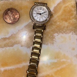 Authentic stainless steel gold tone Coach watch